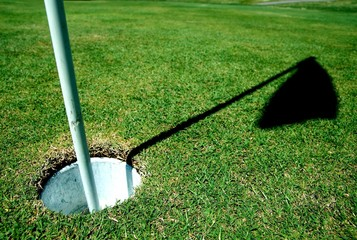 a golf course hole on green