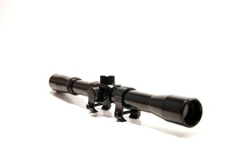 A gun scope 4x20 on a white seemless background.