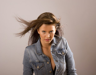 Brunette with Hair Blowing and Jacket Open