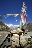 praying flags and stones in annapurna, nepal poster