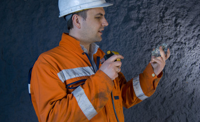 Engineer inspecting mineral