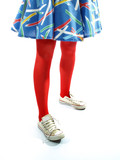Young girls legs in red tights trainers and colourful dress poster
