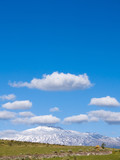 The volcano Etna on the background of cloudy blue sky poster