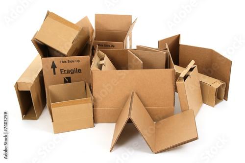 Leinwanddruck Bild Pile of used cardboard boxes