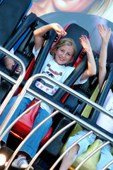 pretty girl on ride at fun fair