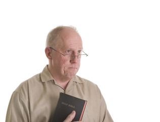 Old Man in Glasses with Bible and Sad Look