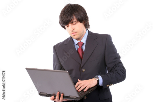 Young business man working with laptop