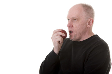 Old Guy in Black Eating an Apple