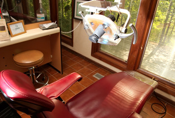 Dentist office chair and light in room