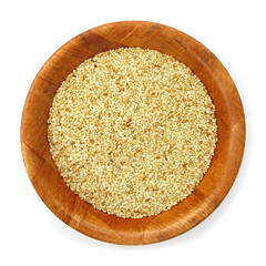 Sesame in wooden dish isolated on white