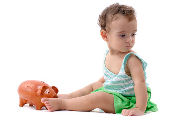 Baby and a pigcoin on white background .