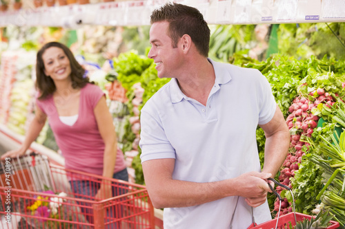 Couple flirting in supermarket