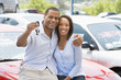 Couple picking up new car - 7433492