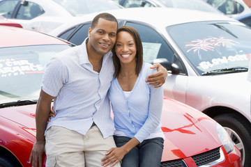 Couple looking at new cars