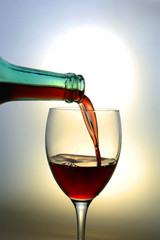 Red wine pouring into a wine glass