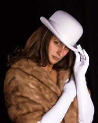 Glamour girl in white hat and gloves