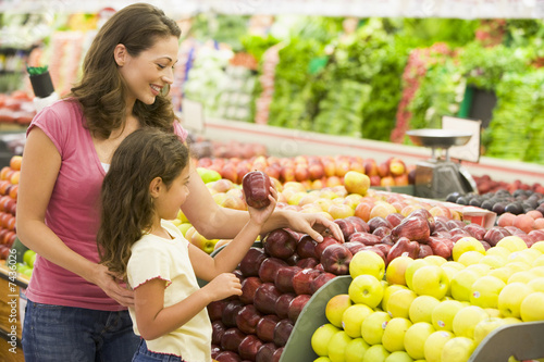 Mother and daughter shopping for fresh produce - 7436026