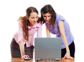 two young attractive women working with the computer
