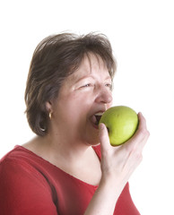 Woman in Red Eating Green Apple