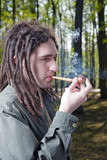 Young man with dreadlock hair. poster