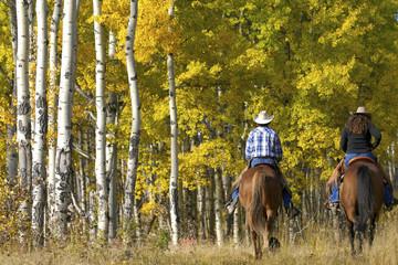Couple On Horseback In Autumn