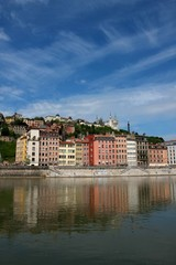 Buildings reflected by the Saone river, Lyon, France