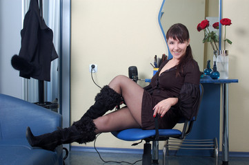 beautiful  barber relaxing at workplace