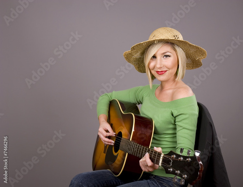 Blonde in Straw Hat Posing with Guitar