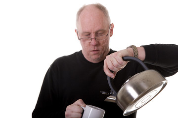Man in Black Pouring Tea into Mug