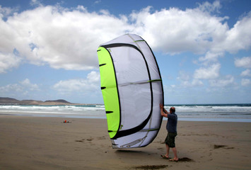 kitesurfer launching kite