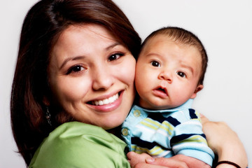 Young mother woman cuddling with baby face to face isolated
