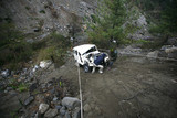 jeep being hauled out of valley after accident poster
