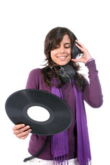 Young Beautiful girl with vinyl and headphones