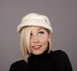 Blonde in fur Hat Looking Up to Left