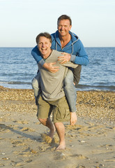 A happy smiling gay couple fooling around.