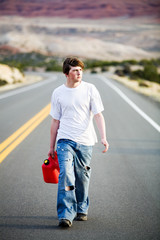 out of gas - teenager male on road with empty gas can