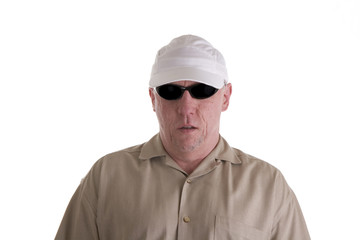 Man in Brown Shirt White Cap and Dark Shades