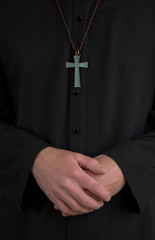 Priest, crucifix and hands