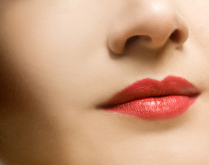 Beautiful woman's face with red lips