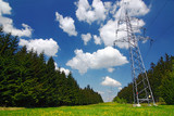 High voltage pylons at spring/summer countryside poster