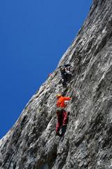 Climber team climbing on rock 1