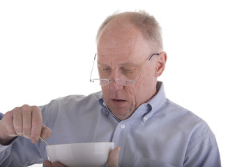 Old Guy in Blue Eating Cereal