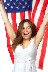 Pretty girl jumping up with flag flying behind her