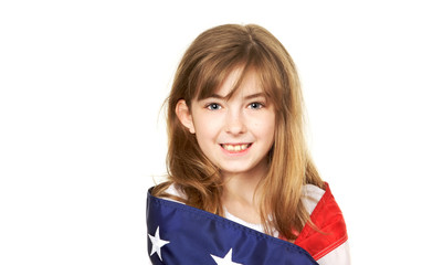 Pretty young child wrapped in a American Flag