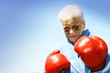 senior woman and boxing gloves
