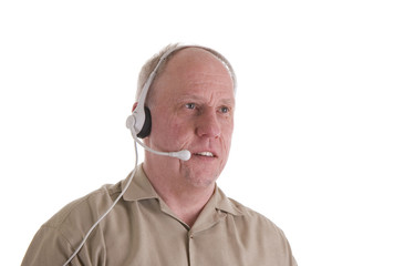 Man in Brown Shirt with Phone Headset