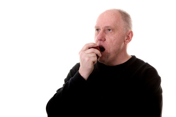 Man in Black Eating a Red Apple