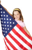 Pretty girl holding the American Flag with a big smile