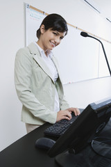 Female lecturer using computer
