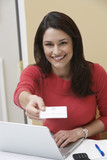 Business woman offering name tag in office, portrait